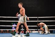 3 August 2019; Michael Conlan, left, reacts after knocking-down Diego Alberto Ruiz during their WBA and WBO Inter-Continental Featherweight title bout at Falls Park in Belfast. Photo by Ramsey Cardy/Sportsfile