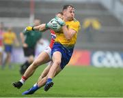 4 August 2019; Aengus Lyons of Roscommon in action against Brian Hurley of Cork during the GAA Football All-Ireland Senior Championship Quarter-Final Group 2 Phase 3 match between Cork and Roscommon at Páirc Uí Rinn in Cork. Photo by Matt Browne/Sportsfile