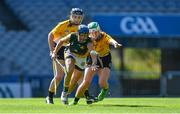 2 August 2019; Keira Kinahan Murphy of Australasia, centre, in action against Siobhán Reynolds, left, and Claire Walsh of Middle East, in the Renault GAA World Games Camogie Irish Cup Final during the Renault GAA World Games 2019 Day 5 - Cup Finals at Croke Park in Dublin. Photo by Piaras Ó Mídheach/Sportsfile