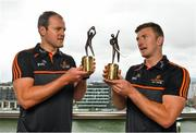 7 August 2019; PwC GAA/GPA Players of the Month for July, footballer Michael Murphy of Donegal, and hurler Patrick Horgan of Cork, were at PwC offices in Dublin today to pick up their respective awards. The players were joined by PwC's Ronan Finn, Uachtarán Cumann Lúthchleas Gael, John Horan, and GPA Chief Executive, Paul Flynn. Pictured are Michael Murphy of Donegal, left, and Patrick Horgan of Cork with their awards at PwC, Spencer Dock, North Wall Quay, Dublin. Photo by Seb Daly/Sportsfile