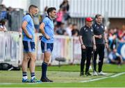 4 August 2019; Bernard Brogan, centre, and Eoghan O'Gara of Dublin await to come on as substitutes during the GAA Football All-Ireland Senior Championship Quarter-Final Group 2 Phase 3 match between Tyrone and Dublin at Healy Park in Omagh, Tyrone. Photo by Brendan Moran/Sportsfile