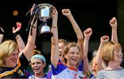 2 August 2019; Stacey Peterson of The Warriors, USGAA, lifts the cup after the Renault GAA World Games Camogie Native Cup Final against Twin Cities, USGAA, during the Renault GAA World Games 2019 Day 5 - Cup Finals at Croke Park in Dublin. Photo by Piaras Ó Mídheach/Sportsfile