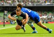 10 August 2019; Andrew Conway of Ireland dives over to score his side's third try, despite the tackle of Matteo Minozzi of Italy, during the Guinness Summer Series 2019 match between Ireland and Italy at the Aviva Stadium in Dublin. Photo by Seb Daly/Sportsfile