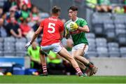 10 August 2019; Shaun Dempsey of Mayo in action against Darragh Cashman of Cork during the Electric Ireland GAA Football All-Ireland Minor Championship Semi-Final match between Cork and Mayo at Croke Park in Dublin. Photo by Piaras Ó Mídheach/Sportsfile