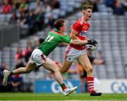 10 August 2019; Conor Corbett of Cork in action against Owen McHale of Mayo during the Electric Ireland GAA Football All-Ireland Minor Championship Semi-Final match between Cork and Mayo at Croke Park in Dublin. Photo by Ray McManus/Sportsfile