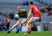 10 August 2019; Paddy Heneghan of Mayo in action against Kelan Scannell of Cork during the Electric Ireland GAA Football All-Ireland Minor Championship Semi-Final match between Cork and Mayo at Croke Park in Dublin. Photo by Piaras Ó Mídheach/Sportsfile