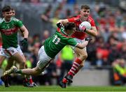 10 August 2019; Conor Corbett of Cork fends off Owen McHale of Mayo during the Electric Ireland GAA Football All-Ireland Minor Championship Semi-Final match between Cork and Mayo at Croke Park in Dublin. Photo by Piaras Ó Mídheach/Sportsfile