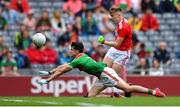 10 August 2019; Daniel Linehan of Cork shoots to score his side's second goal under pressure from Eoin Gilraine of Mayo during the Electric Ireland GAA Football All-Ireland Minor Championship Semi-Final match between Cork and Mayo at Croke Park in Dublin. Photo by Piaras Ó Mídheach/Sportsfile