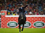 10 August 2019; Alexander Kisselbach of Germany, competing on Gannan, celebrates during the Land Rover Puissance at the Stena Line Dublin Horse Show 2019 at the RDS in Dublin. Photo by Harry Murphy/Sportsfile