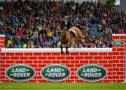 10 August 2019; Michael Pender of Ireland, competing on Hearton Du Bois Halleux, during the Land Rover Puissance at the Stena Line Dublin Horse Show 2019 at the RDS in Dublin. Photo by Harry Murphy/Sportsfile