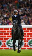 10 August 2019; Alexander Kisselbach of Germany, competing on Gannan, celebrates clearing 2 metres during the Land Rover Puissance at the Stena Line Dublin Horse Show 2019 at the RDS in Dublin. Photo by Harry Murphy/Sportsfile