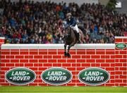 10 August 2019; Mathieu Billot of France, competing on Dassler, jumps to win the Land Rover Puissance at the Stena Line Dublin Horse Show 2019 at the RDS in Dublin. Photo by Harry Murphy/Sportsfile