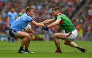 10 August 2019; Ciarán Kilkenny of Dublin is tackled by Séamus O'Shea of Mayo during the GAA Football All-Ireland Senior Championship Semi-Final match between Dublin and Mayo at Croke Park in Dublin. Photo by Ray McManus/Sportsfile