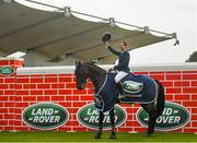 10 August 2019; Mathieu Billot of France, competing on Dassler, celebrates winning the Land Rover Puissance at the Stena Line Dublin Horse Show 2019 at the RDS in Dublin. Photo by Harry Murphy/Sportsfile