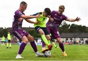 10 August 2019; Stephen O'Leary of Cobh Ramblers in action against James Carroll, left, and John Mountney of Dundalk during the Extra.ie FAI Cup First Round match between Cobh Ramblers and Dundalk at St. Colman's Park in Cobh, Co. Cork. Photo by Eóin Noonan/Sportsfile