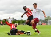 11 August 2019; Cian McMullan of Killester Donnycarney in action against Ajitola Sule, left, and Bobinel Mazono of Lucan United during the Extra.ie FAI Cup First Round match between Lucan United and Killester Donnycarney at Celbridge Football Park in Kildare. Photo by Seb Daly/Sportsfile