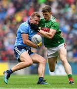10 August 2019; Ciaran Kilkenny of Dublin is tackled by Eoin O'Donoghue of Mayo during the GAA Football All-Ireland Senior Championship Semi-Final match between Dublin and Mayo at Croke Park in Dublin. Photo by Ramsey Cardy/Sportsfile