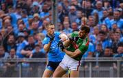 10 August 2019; Aidan O'Shea of Mayo and Paul Mannion of Dublin during the GAA Football All-Ireland Senior Championship Semi-Final match between Dublin and Mayo at Croke Park in Dublin. Photo by Stephen McCarthy/Sportsfile