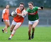10 August 2019; Catherine Marley of Armaghin action against Ciara McManamon of Mayo during the TG4 All-Ireland Ladies Football Senior Championship Quarter-Final match between Mayo and Armagh at Glennon Brothers Pearse Park in Longford. Photo by Matt Browne/Sportsfile