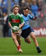 10 August 2019; Elliot Friel, Scoil Iosagáin Buncrana, Inishowen, Donegal, representing Mayo, and Mason Melia, Newtownmountkennedy PS, Newtownmountkennedy, Wicklow, representing Dublin, during the INTO Cumann na mBunscol GAA Respect Exhibition Go Games during the GAA Football All-Ireland Senior Championship Semi-Final match between Dublin and Mayo at Croke Park in Dublin. Photo by Ramsey Cardy/Sportsfile