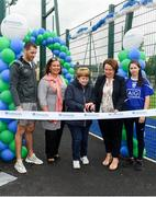 11 August 2019; Dublin duo hurler Eamonn Dillon and camogie player Siobhan Kehoe both from Naomh Fionbarra GAA Club are pictured with Community Credit Union representative Sue Callanan, Mary Lou McDonald TD and Naomh Fionnbarr chairperson Eilis Uí Longain at the launch of Community Credit Union's 10-year sponsorship of the new 'Community Park' pitch at Naomh Fionnbarra GAA Club in Cabra, Dublin, marking the first day of Naomh Fionnbarra's Festival Week 2019. Photo by Harry Murphy/Sportsfile