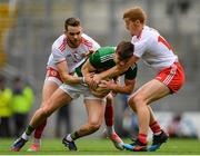 11 August 2019; Seán O'Shea of Kerry is tackled by Ronan McNamee, left, and Peter Harte of Tyrone during the GAA Football All-Ireland Senior Championship Semi-Final match between Kerry and Tyrone at Croke Park in Dublin. Photo by Ramsey Cardy/Sportsfile