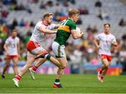 11 August 2019; Tommy Walsh of Kerry in action against Frank Burns of Tyrone during the GAA Football All-Ireland Senior Championship Semi-Final match between Kerry and Tyrone at Croke Park in Dublin. Photo by Ray McManus/Sportsfile