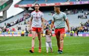 11 August 2019; Colm Cavanagh of Tyrone, left, and his daughter Chloe, leave the pitch with team-mate Michael McKernan after the GAA Football All-Ireland Senior Championship Semi-Final match between Kerry and Tyrone at Croke Park in Dublin. Photo by Brendan Moran/Sportsfile