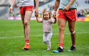 11 August 2019; Chloe Cavanagh, daughter of Colm Cavanagh of Tyrone, leaves the pitch with her father and his team-mate Michael McKernan after the GAA Football All-Ireland Senior Championship Semi-Final match between Kerry and Tyrone at Croke Park in Dublin. Photo by Brendan Moran/Sportsfile