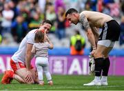 11 August 2019; Colm Cavanagh of Tyrone with his daughter Chloe and team-mate Niall Morgan after the GAA Football All-Ireland Senior Championship Semi-Final match between Kerry and Tyrone at Croke Park in Dublin. Photo by Brendan Moran/Sportsfile