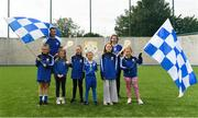 11 August 2019; Dublin duo hurler Eamonn Dillon and camogie player Siobhan Kehoe both from Naomh Fionbarra GAA Club are pictured with young Naomh Fionnbarr players at the launch of Community Credit Union's 10-year sponsorship of the new 'Community Park' pitch at Naomh Fionnbarra GAA Club in Cabra, Dublin, marking the first day of Naomh Fionnbarra's Festival Week 2019. Photo by Harry Murphy/Sportsfile