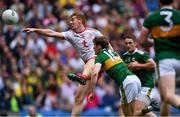 11 August 2019; Peter Harte of Tyrone fists the ball goalwards during the GAA Football All-Ireland Senior Championship Semi-Final match between Kerry and Tyrone at Croke Park in Dublin. Photo by Piaras Ó Mídheach/Sportsfile