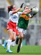 11 August 2019; Marie Cranny, Bennekerry NS, Bennekerry, Carlow, representing Kerry, in action against Ella Treacey, St. Mary's PS, Cookstown, Tyrone, representing Tyrone, during the INTO Cumann na mBunscol GAA Respect Exhibition Go Games during the GAA Football All-Ireland Senior Championship Semi-Final match between Kerry and Tyrone at Croke Park in Dublin. Photo by Brendan Moran/Sportsfile