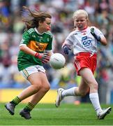 11 August 2019; Philomena Gillman, Mullinahone NS, Mullinahone, Tipperary, representing Kerry, in action against Kate Murray, Clooneyquinn NS, Castlerea, Roscommon, representing Tyrone, during the INTO Cumann na mBunscol GAA Respect Exhibition Go Games during the GAA Football All-Ireland Senior Championship Semi-Final match between Kerry and Tyrone at Croke Park in Dublin. Photo by Brendan Moran/Sportsfile