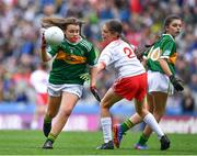 11 August 2019; Philomena Gillman, Mullinahone NS, Mullinahone, Tipperary, representing Kerry, in action against Méabh McGoldrick, Ovens NS, Ovens, Cork, representing Tyrone, during the INTO Cumann na mBunscol GAA Respect Exhibition Go Games during the GAA Football All-Ireland Senior Championship Semi-Final match between Kerry and Tyrone at Croke Park in Dublin. Photo by Brendan Moran/Sportsfile