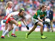 11 August 2019; Emma Lynch, Gilson NS, Oldcastle, Meath, representing Kerry, in action against Amy Jo Kierans, Latnamard, Smithborough, Monaghan, representing Tyrone, during the INTO Cumann na mBunscol GAA Respect Exhibition Go Games during the GAA Football All-Ireland Senior Championship Semi-Final match between Kerry and Tyrone at Croke Park in Dublin. Photo by Brendan Moran/Sportsfile