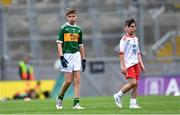 11 August 2019; Matthew Whitmore, St. Columban's PS, Belcoo, Fermanagh, representing Kerry, and Colm McGuckian, Sacred Heart NS, Aughrim, Wicklow, representing Tyrone, during the INTO Cumann na mBunscol GAA Respect Exhibition Go Games during the GAA Football All-Ireland Senior Championship Semi-Final match between Kerry and Tyrone at Croke Park in Dublin. Photo by Piaras Ó Mídheach/Sportsfile