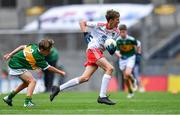 11 August 2019; Jamie Dorr, Scoil Mhuire, Newtownforbes, Longford, representing Tyrone,  in action against James O'Malley, Lisnagry NS, Lisnagry, Limerick, representing Kerry, during the INTO Cumann na mBunscol GAA Respect Exhibition Go Games during the GAA Football All-Ireland Senior Championship Semi-Final match between Kerry and Tyrone at Croke Park in Dublin. Photo by Piaras Ó Mídheach/Sportsfile