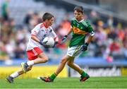 11 August 2019; Turlough Carr, St Francis, Barnesmore, Donegal Town, Donegal, representing Tyrone, in action against Ruarc Sweeney, Clara NS Clara, Kilkenny, representing Kerry, during the INTO Cumann na mBunscol GAA Respect Exhibition Go Games during the GAA Football All-Ireland Senior Championship Semi-Final match between Kerry and Tyrone at Croke Park in Dublin. Photo by Piaras Ó Mídheach/Sportsfile