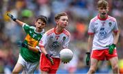 11 August 2019; Conor Bodkin, St. Patricks PS, Tuam, Galway, representing Tyrone, supported by team-mate Shane Mullarkey, Ballyroan Boys NS, Rathfarnham, Dublin, representing Tyrone, in action against Ruarc Sweeney, Clara NS Clara, Kilkenny, representing Kerry, during the INTO Cumann na mBunscol GAA Respect Exhibition Go Games during the GAA Football All-Ireland Senior Championship Semi-Final match between Kerry and Tyrone at Croke Park in Dublin. Photo by Piaras Ó Mídheach/Sportsfile