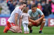 11 August 2019; Colm Cavanagh of Tyrone and his daughter Chloe with team-mate Michael McKernan after the GAA Football All-Ireland Senior Championship Semi-Final match between Kerry and Tyrone at Croke Park in Dublin. Photo by Brendan Moran/Sportsfile