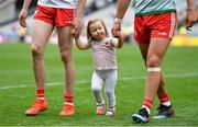 11 August 2019; Chloe Cavanagh leaves the pitch with her father Colm Cavanagh of Tyrone and his team-mate Michael McKernan after the GAA Football All-Ireland Senior Championship Semi-Final match between Kerry and Tyrone at Croke Park in Dublin. Photo by Brendan Moran/Sportsfile