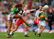 11 August 2019; Alexandra Peter, Castlerara NS, Drumohan, Cavan, representing Kerry, in action against Ellie Mulroe, Scoil Treasa Senior NS, Firhouse, Dublin, representing Tyrone, during the INTO Cumann na mBunscol GAA Respect Exhibition Go Games during the GAA Football All-Ireland Senior Championship Semi-Final match between Kerry and Tyrone at Croke Park in Dublin. Photo by Eóin Noonan/Sportsfile
