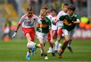 11 August 2019; Aaron Waterhouse, Drimnagh Castle PS, Walkinstown, Dublin, representing Tyrone, in action against Senan Buckley, Scoil Chros tSeáin, Crosshaven, Cork, representing Kerry, and Ronan Keavey, St. Joseph's NS, Miltown Malbay, Clare, representing Kerry, during the INTO Cumann na mBunscol GAA Respect Exhibition Go Games during the GAA Football All-Ireland Senior Championship Semi-Final match between Kerry and Tyrone at Croke Park in Dublin. Photo by Ramsey Cardy/Sportsfile
