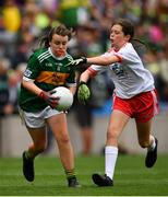 11 August 2019; Philomena Gillman, Mullinahone NS, Mullinahone, Tipperary, representing Kerry, in action against Méabh McGoldrick, Ovens NS, Ovens, Cork, representing Tyrone, during the INTO Cumann na mBunscol GAA Respect Exhibition Go Games during the GAA Football All-Ireland Senior Championship Semi-Final match between Kerry and Tyrone at Croke Park in Dublin. Photo by Ramsey Cardy/Sportsfile