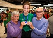 12 August 2019; Member of the Ireland basketball bronze medallist squad, Rachel Huijsdens is greeted by her grandparents Bernie and Vincent Lane, from Dunsaughlin, Meath, on her return from the FIBA U20 Women's European Championships Division B Finals, held in Kosovo, at Dublin Airport in Dublin. Photo by Stephen McCarthy/Sportsfile