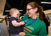 12 August 2019; Strength and conditioning coach with the Ireland basketball bronze medallist squad Elaine Kennington is greeted by her niece 11-month-old Mia O'Carroll on her return from the FIBA U20 Women's European Championships Division B Finals, held in Kosovo, at Dublin Airport in Dublin. Photo by Stephen McCarthy/Sportsfile