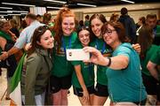 12 August 2019; Members of the Ireland basketball bronze medallist squad, from left, Maggie Byrne, Enya Maguire and Dayna Finn pose for a photograph with Annie McKeon, left, and Rita Campbell on their return from the FIBA U20 Women's European Championships Division B Finals, held in Kosovo, at Dublin Airport in Dublin. Photo by Stephen McCarthy/Sportsfile
