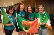 12 August 2019; Members of the Ireland basketball bronze medallist squad Maggie Byrne, left, and Dayna Finn, both from Kiltimagh, Mayo, pose for a photograph with Rita Campbell, left, and Vera McKeon right, on their return from the FIBA U20 Women's European Championships Division B Finals, held in Kosovo, at Dublin Airport in Dublin. Photo by Stephen McCarthy/Sportsfile