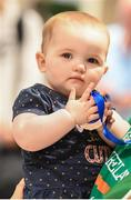 12 August 2019; 11-month-old Mia O'Carroll holds the medal belong to her aunt, strength and conditioning coach with the Ireland basketball bronze medallist squad Elaine Kennington, on the squad's return from the FIBA U20 Women's European Championships Division B Finals, held in Kosovo, at Dublin Airport in Dublin. Photo by Stephen McCarthy/Sportsfile